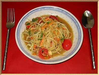 A photo of a plate of Som tam, which is Thai Papaya Salad. This will blow your socks off.